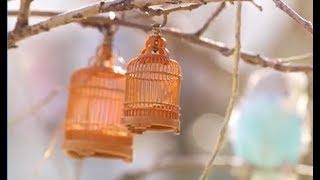 A retired birdcage-maker in Beijing creates miniatures birdcages by handcrafts