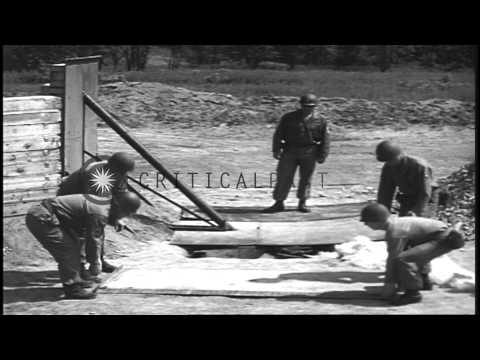 US Army soldiers destroy ammunition by burning it in an open field in the United ...HD Stock Footage