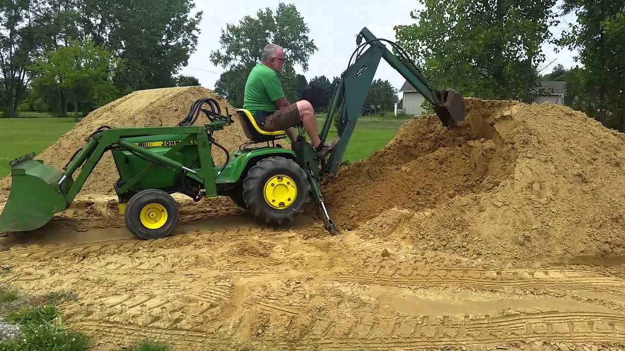 John Deere 317 with Brantly Manufacturing Implements - YouTube