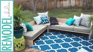 Need a good place to take a nap in your backyard? YES PLEASE!! This EASY, modern, DIY, plywood, sofa sectional is the