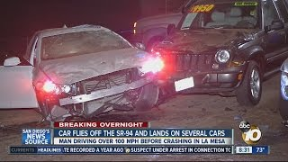 Car flies off SR-94 and lands on several cars
