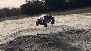 WPL C24 tests suspension upgrade by going off jump and drifting in dirt