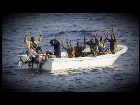 Somali pirates attack a giant merchant ship in the Gulf of Aden
