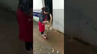A Chinies girl stripped of a live full snake's skin
