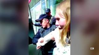 Police manhandle young mum as she holds crying baby while they try to arrest her for selling HERBS