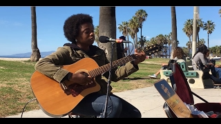 doc watson deep river blues cover by sunny war busking in the streets of los angeles usa