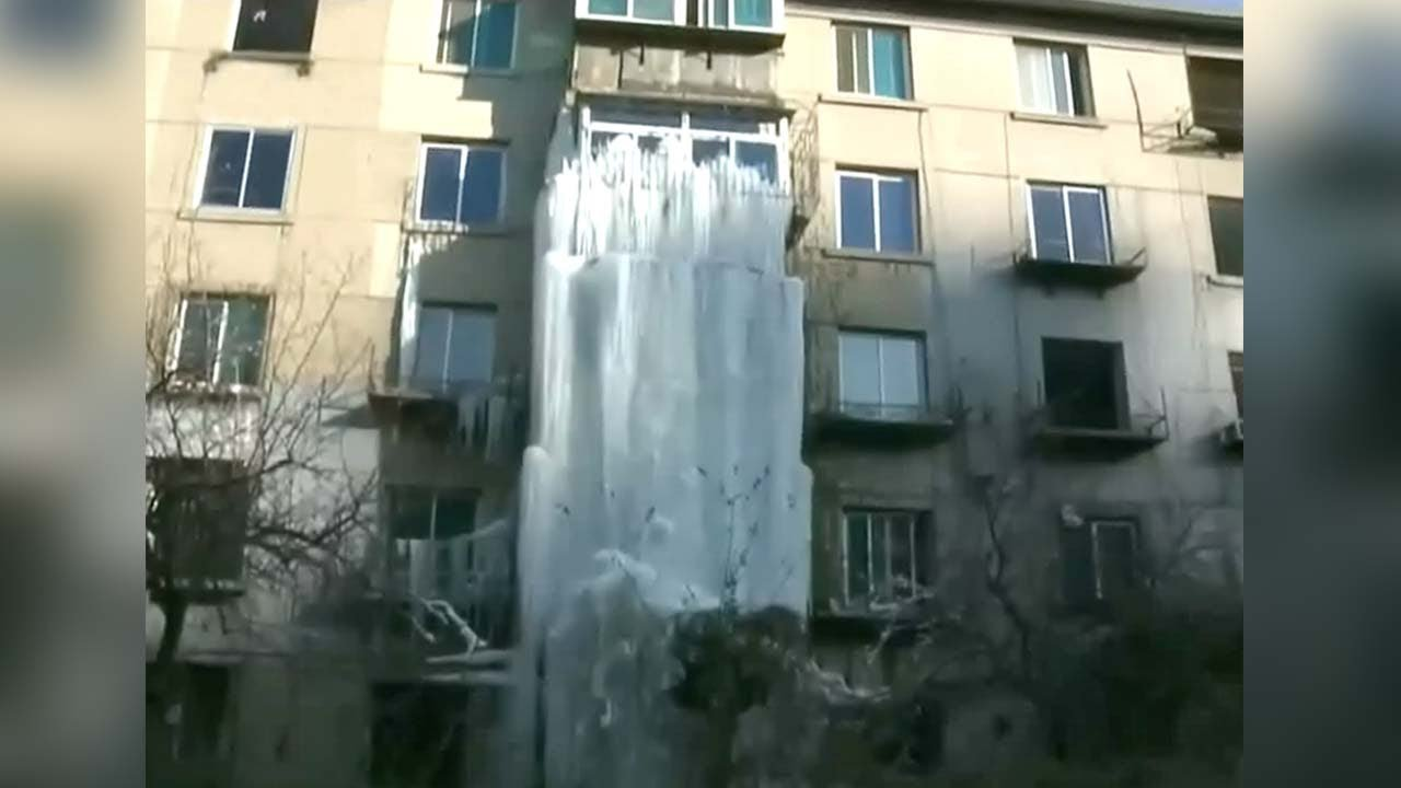 Water leaking from building freezes into 10m waterfall in for House built on waterfall