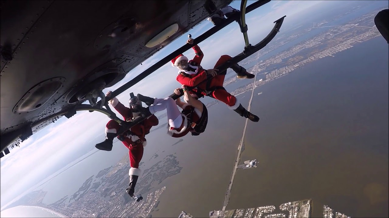 Santa Skydivers Drop From Helicopter Cocoa Beach Pier