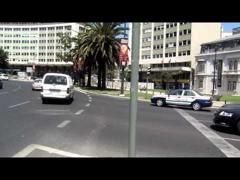 Lisbon, Portugal - crossing huge traffic circle near Marques De Pombal metro stop.