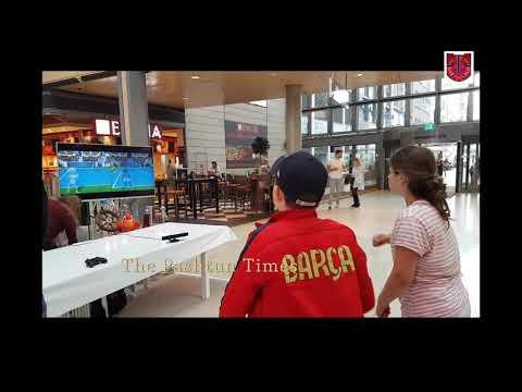 Kids playing Wii tennis at Hamburg Mall