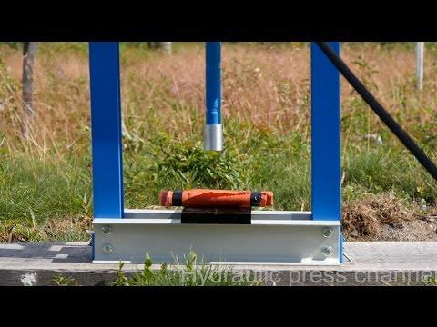 Crushing dynamite with hydraulic press