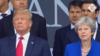 Awkward: Theresa May and Donald Trump at Nato summit