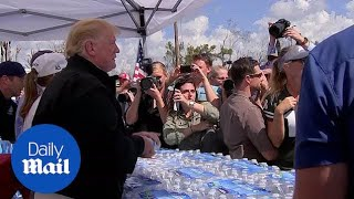 Trump and Melania meet with Hurricane survivors in Florida