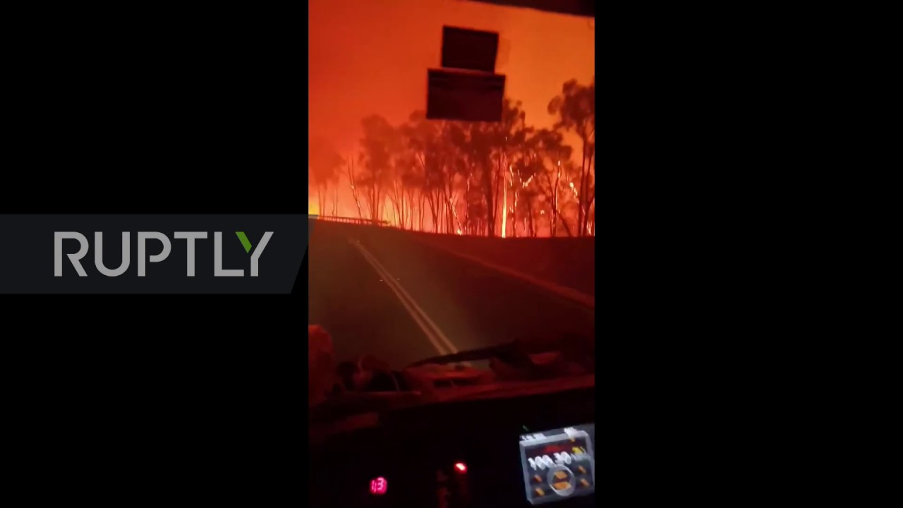 Australia: Dramatic footage shows firefighters driving through hellish landscape - RUPTLY