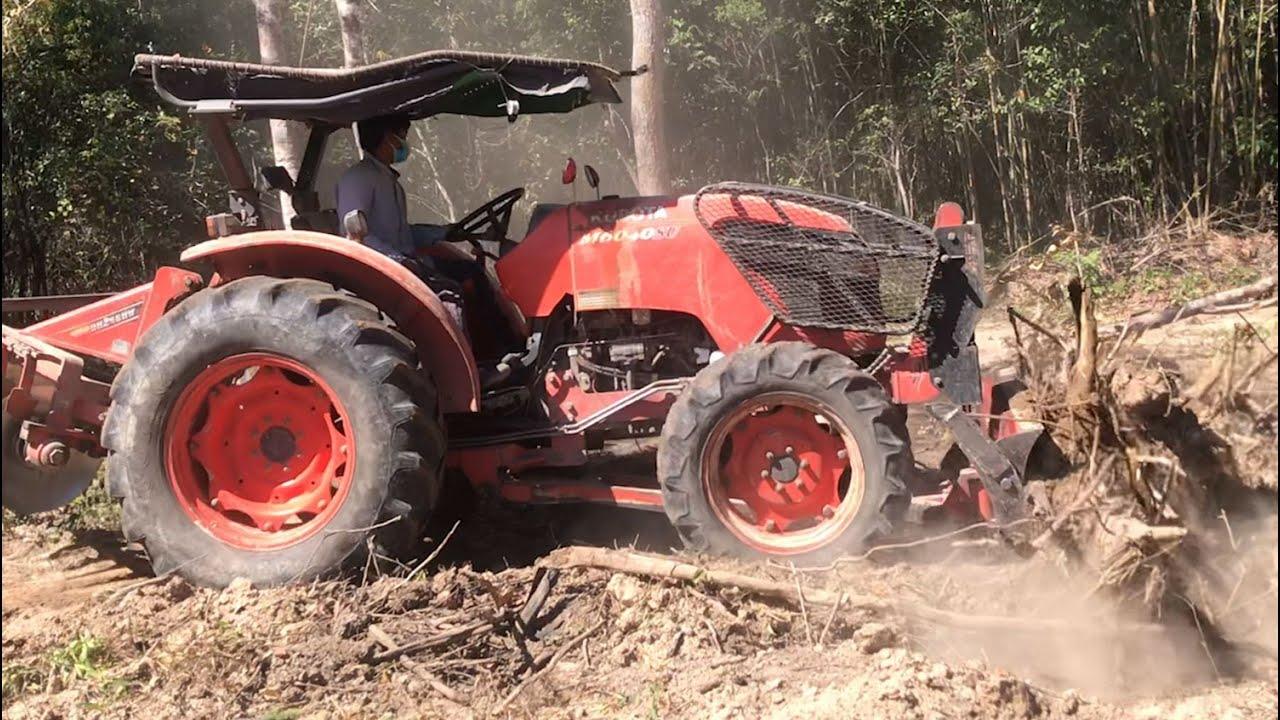 Kubota Tractor in Action - Tractor Pushing Dirt Skills ត្រាក់ទ័រវ័យព្រៃធ្វើចំការ