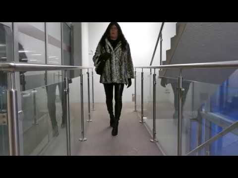 Jenny crossdresser in Thigh high boots and fur jacket