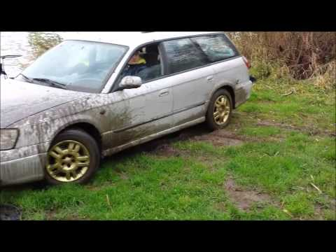Subaru Legacy 2000 in deep mud