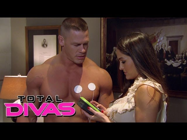 Nikki Bella plays with John Cena's muscle stimulator: Total Divas, December 8, 2013 Travel Video