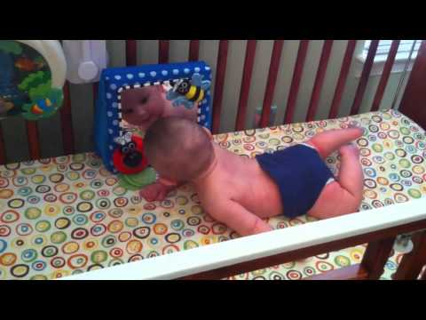 Playing in his crib