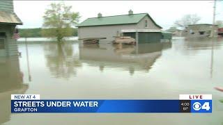 Flooding Missouri waterways close roads, strain levees
