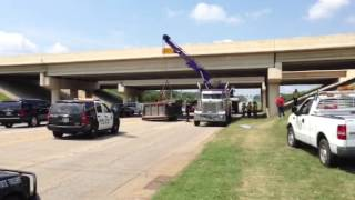 Dump truck hits bridge in Broken Arrow