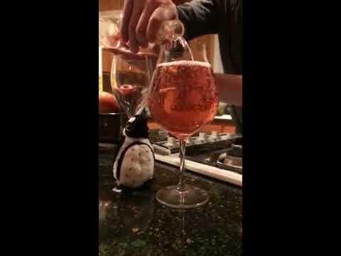 A Wine Bottle Fills a Riedel Oregon Pinot Noir Wine Glass