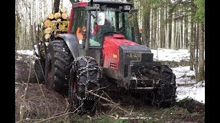 Valtra 6850 forestry tractor logging in wet winter forest