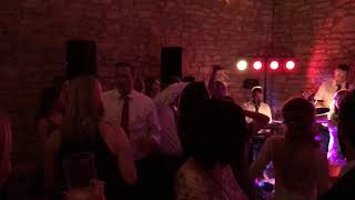 The Supers playing Ghostbusters Thriller at a wedding reception