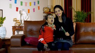 Young mom playing with her cute kid in casual winter wear - lifestyle Indian families