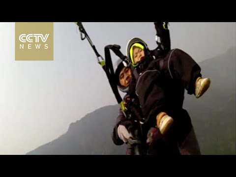 Chinese toddler tries out paragliding