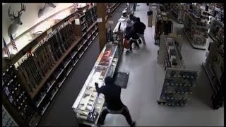Manhunt Underway for Gang Caught on Camera Stealing Arsenal of Weapons
