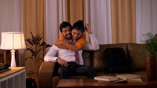 Indian wife cheering and hugging his tired husband after office in the evening - Love and Care
