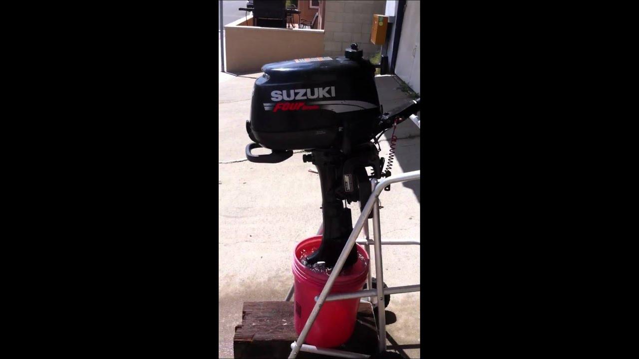 Suzuki 4 hp outboard boat motor - YouTube