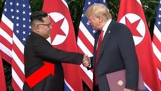 Trump uses his FAMOUS PULL HANDSHAKE ON KIM JONG UN