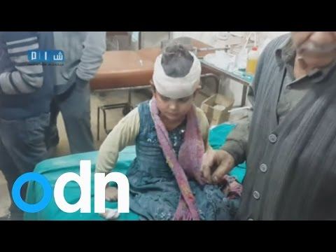 Syrian civilians attacked by barrel bombs in Damascus shown in amateur video