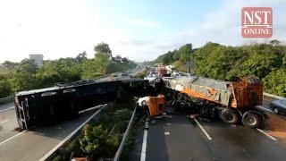 Driver killed, 2 injured as two trailers crash at Alor Gajah
