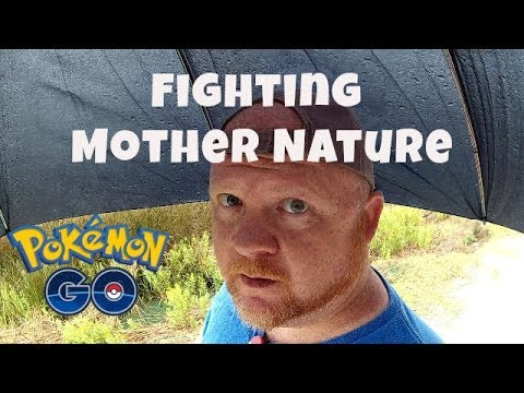 Pokemon GO   Braving A Thunderstorm For The Rock Event   Dropping Lures Under My Umbrella