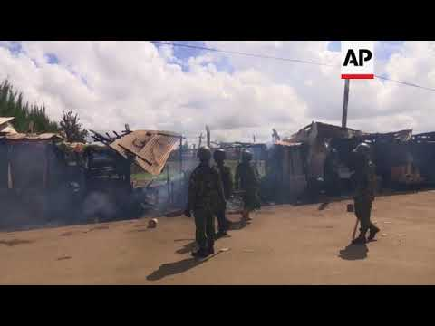 Kenya police fire tear gas at opposition protesters as Kenyatta sworn-in