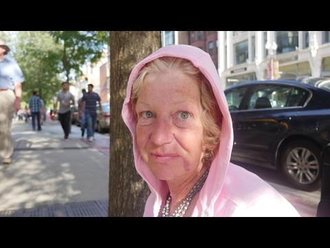 Homeless woman sleeps on the streets of Boston