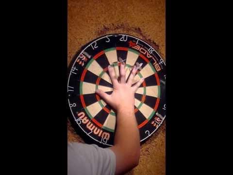 darts trick darts thrown between fingers