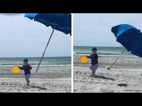Shelley Wade - Toddler Nearly Impaled By Flying Beach Umbrella