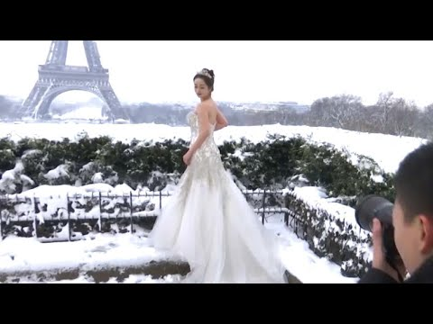 Newlyweds Battle Snow to Take Romantic Freezing Photos in Front of Eiffel Tower