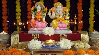 Tilt shot of Laxmi Ganesh Idols with decorated puja thali on the festival of Diwali