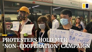 Protesters gather at Hong Kong MTR stations to remind passengers of Yuen Long attack