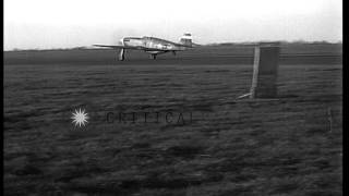 P-51 Mustang fighter aircraft of 354th Fighter Group landing at advanced air stri...HD Stock Footage
