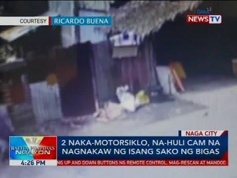 2 naka-motorsiklo, na-huli cam na nagnakaw ng isang sako ng bigas