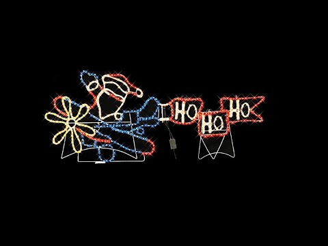 lighting display santa in plane with ho ho ho the christmas warehouse