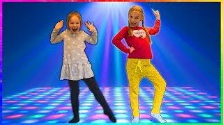 Amelia and Avelina eat a magical apple and hold a dance contest. thumbnail