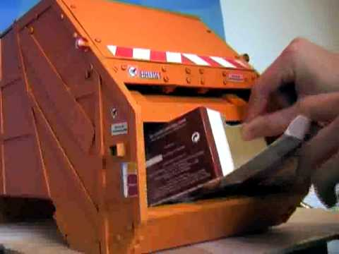 Working garbage compactor truck miniature model sch rling What is trash compactor and how does it work