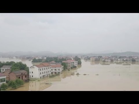 Heavy rains flood more than 200 villages in southern China